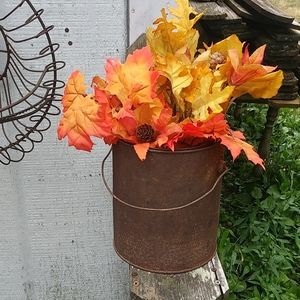 RUSTY CAN WITH DOWELS